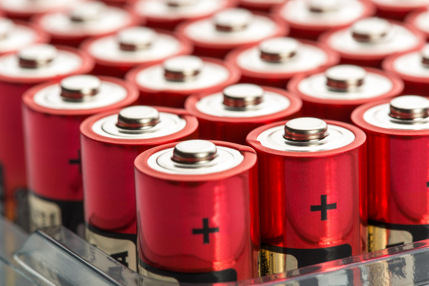 Many red AA batteries in a row
